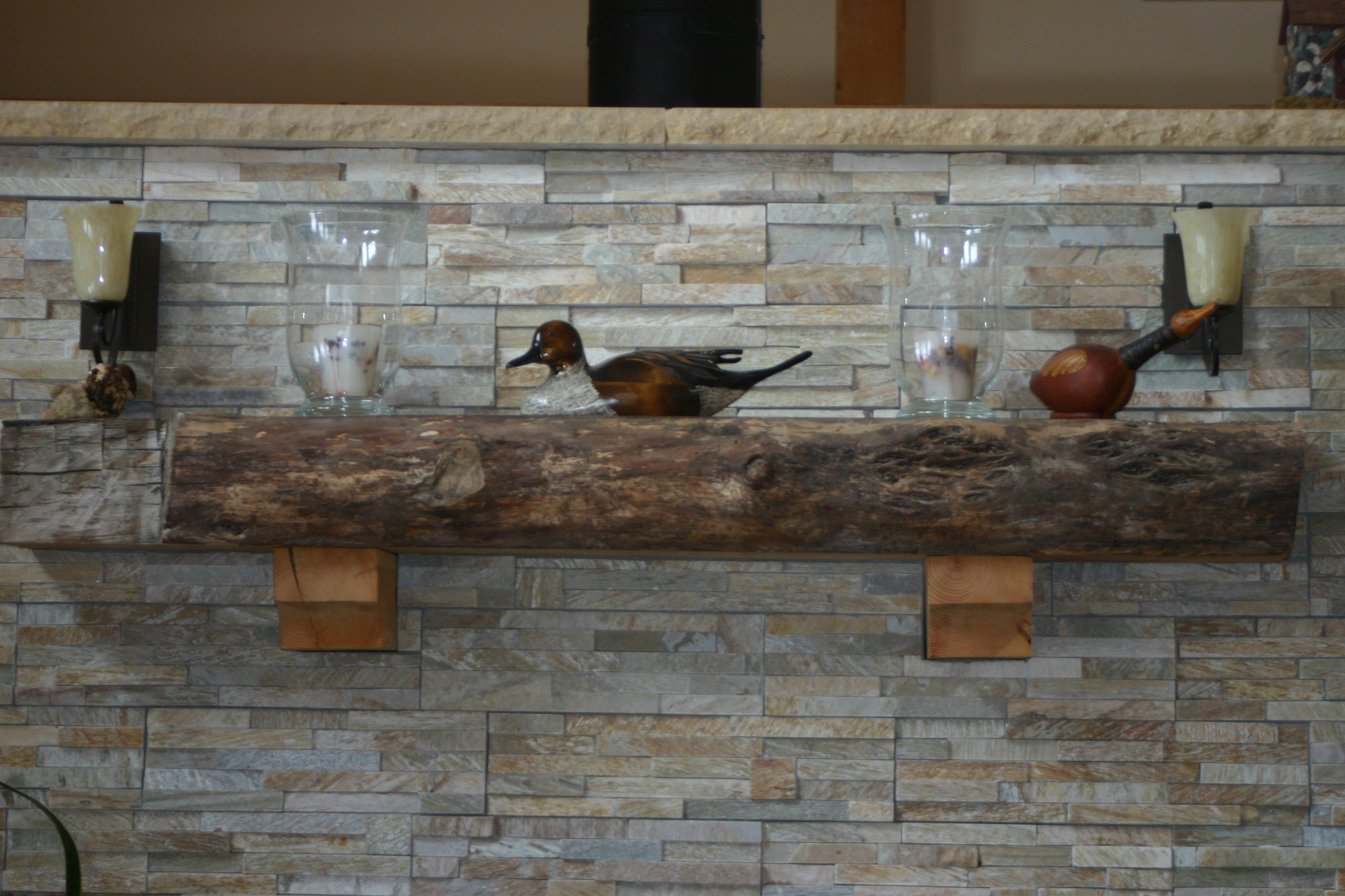 snippet of the star of our fireplace diy the plan is to have stone
